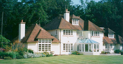 A single-storey extension to a Voysey-style house, Chalfont St. Giles
